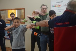 group class of archers using resistance bands